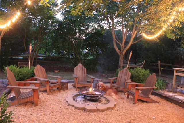 yard fire pit area ideas pine needle mulch bed front yard landscaping