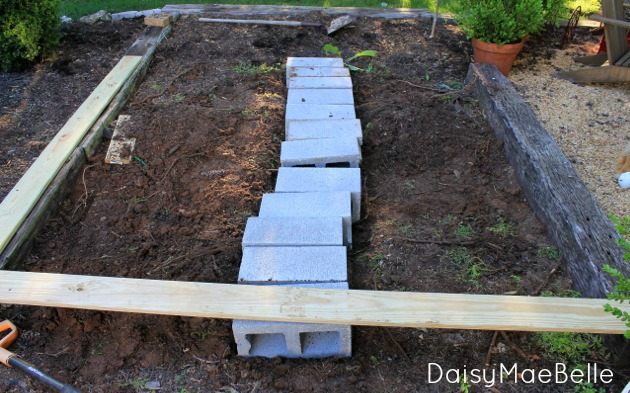Using concrete block and railroad ties to install a new deck @ DaisyMaeBelle